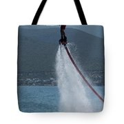 Flyboarder In Silhouette Balancing High Above Water Tote Bag
