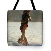 Flyboarder Twisting Upper Body Just Above Waves Tote Bag
