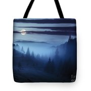 Fog Around The Mountain Top At Night Tote Bag