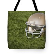 Football Helmet On Artificial Turf Tote Bag