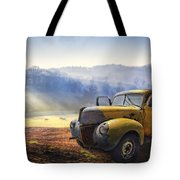 Ford In The Fog Tote Bag by Debra and Dave Vanderlaan