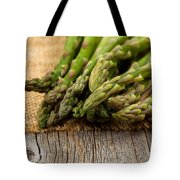 Fresh Asparagus On Napkin And Rustic Wood  Tote Bag