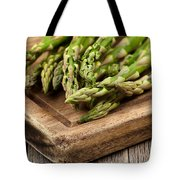 Fresh Asparagus On Rustic Wooden Server Board Tote Bag
