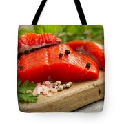 Fresh Copper River Salmon Fillets On Rustic Wooden Server With S Tote Bag