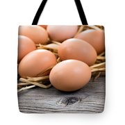 Fresh Organic Eggs On Rustic Wooden Boards And Straw Tote Bag