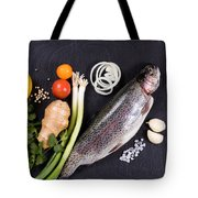 Fresh Whole Raw Fish And Herbs Displayed On Natural Slate Stone  Tote Bag