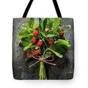 fresh Wild strawberries on wooden background  Tote Bag