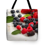 Freshly Picked Berries On Rustic White Wooden Boards Tote Bag