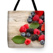 Freshly Picked Berries On Rustic Wooden Boards Tote Bag