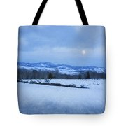 Full Moon Over A Field Of Snow Tote Bag