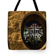 Illuminated Night View - Beautiful Revival House Through A Fence Window Tote Bag