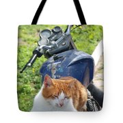 Ginger And White Tabby Cat Sunbathing On A Motorcycle Tote Bag
