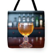Goblet Of Refreshing Golden Beer On Shiny Dining Table Tote Bag