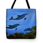 Graceful Dolphins At Play. Tote Bag