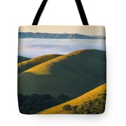 Green Hills And Low Clouds Tote Bag