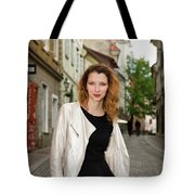 Grinning Attractive Woman Standing On Cobblestone Street Of Uppe Tote Bag