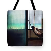 Guy With The Hat Lying In A Hammock On The Porch Of The Old House And Relaxing By The Caribbean Sea Tote Bag