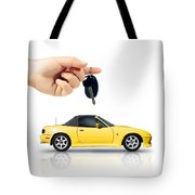 Hand Holding Key To Yellow Sports Car Tote Bag