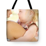 Happy Mother Holding Baby With Look Of Surprise Tote Bag