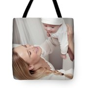 Happy Mother With Her Baby Tote Bag