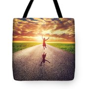 Happy Woman Jumping On Long Straight Road Tote Bag