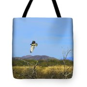 Hawk In Flight Over The Desert Tote Bag