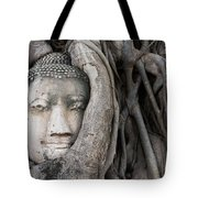 Head Of Buddha Statue In The Tree Roots Tote Bag
