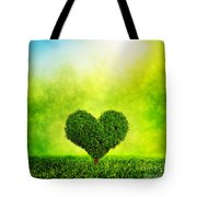 Heart Shaped Tree Growing On Green Grass Tote Bag