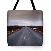 Highway Straight Road Leading To The Snowy Mountains Tote Bag