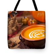Homemade Pumpkin Soup On A Rustic Table With Autumn Decorations Tote Bag