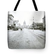 In This Historical 1913 Photo, Horse Drawn Carriages In Downtown Austin, Texas Run Up And Down Congress Avenue Cobblestone Streets Leading Up The The Texas State Capitol Tote Bag