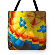 Inflating The Balloon Tote Bag