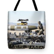Irman Assists In Lowering A Guided Bomb Tote Bag