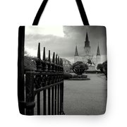 Jackson Square Gate With St. Louis Cathedral And Storm Clouds Tote Bag