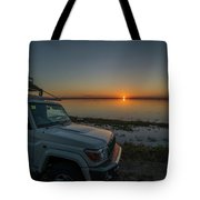Jeep Driver Watching Sunset Over Peaceful River Tote Bag