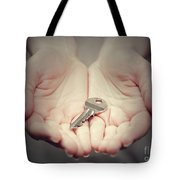 Key In Woman's Hand In Gesture Of Giving. Concept Of Success In Live, Business Solution, Real Estate Etc Tote Bag