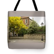 Lamppost On A Street Bend. Tote Bag