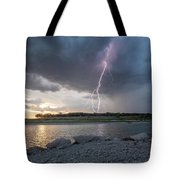 Large Lighting From Dark Clouds During Sunset At Large Lake Tote Bag