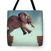 Leap Of Faith Concept Elephant Jumping Across A Crevasse Tote Bag
