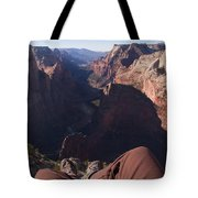 Legs Dangle Over The Cliff Looking Tote Bag