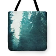 Light Coming Through Fir Trees In Mist Tote Bag