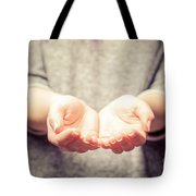 Light In Young Woman's Hands Tote Bag