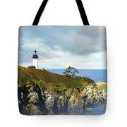 Lighthouse On A Jetty. Tote Bag