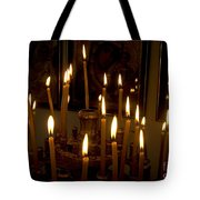 lit Candles in church  Tote Bag