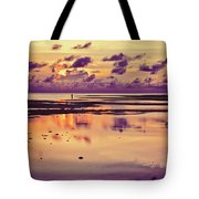 Lone Fisherman In Distance During Beautiful Reflected Sunset With Dramatic Clouds In Maldives Tote Bag