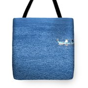 Lonely Fishing Boat Sailing On A Calm Blue Sea Tote Bag