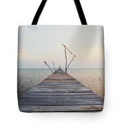 Long, Empty And Old Wooden Dock Over The Water At Sunset Tote Bag