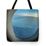 Looking Out Of Airplane Window During Flight Tote Bag