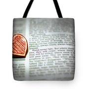 Love Never Fails Tote Bag