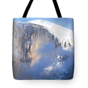 Low Angle View Of A Mountain Covered Tote Bag
